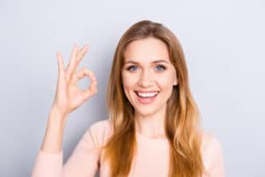 People body language facial emotion expressions people person concept. Close up portrait of excited lovely delightful cute confident manager making ok sign isolated on gray background coy-space